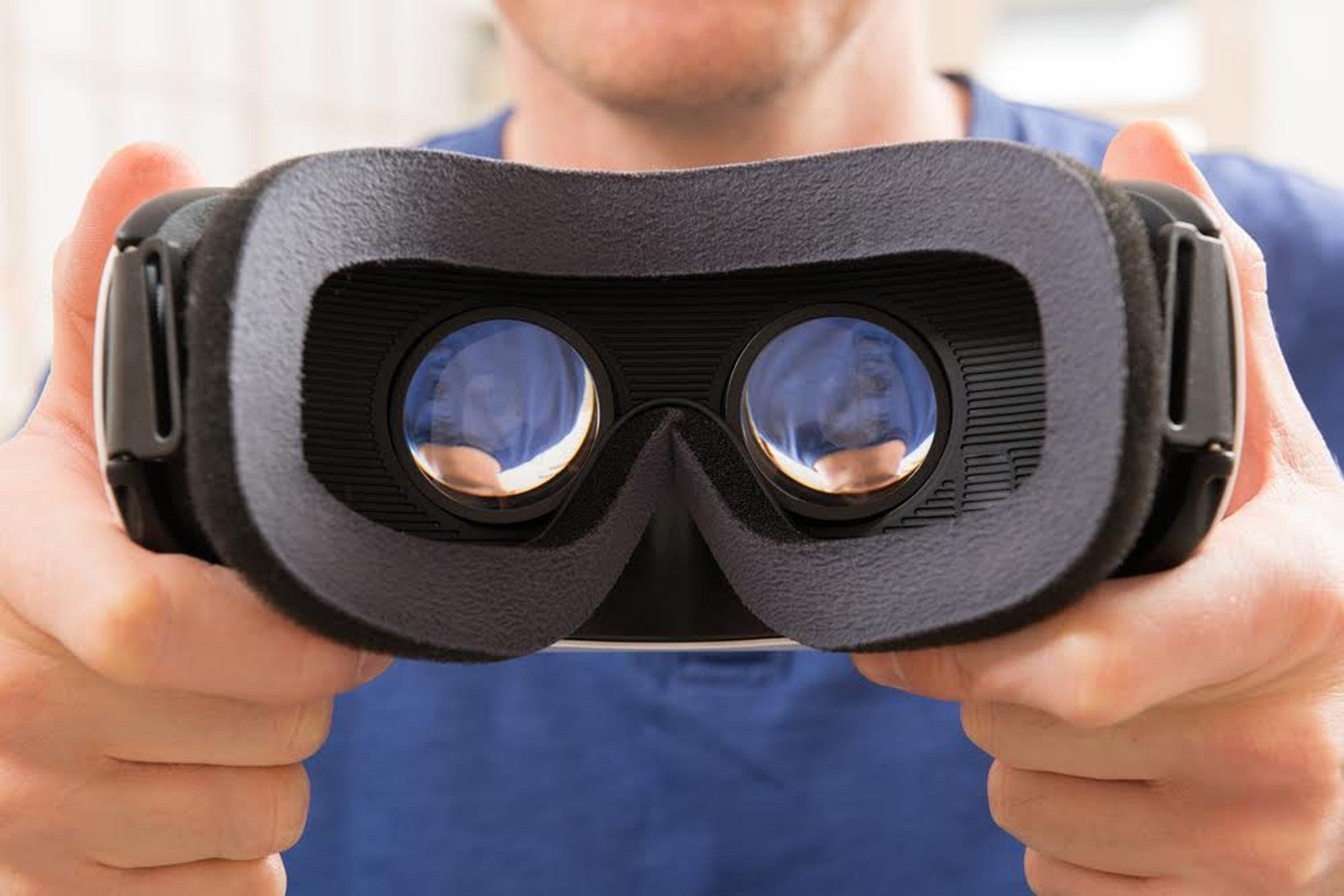 Man holding VR headset